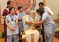 Children tying 'Rakhi' on the Prime Minister, Shri Narendra Modi's wrist, on the occasion of 'Raksha Bandhan', in New Delhi on August 29, 2015 (12).jpg