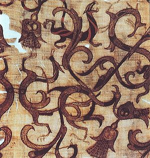 Chain stitch - Detail of an embroidered silk gauze ritual garment from a 4th-century BC, Zhou era tomb at Mashan, Hubei province, China. Rows of even, round chain-stitches are used both for outline and to fill in color.