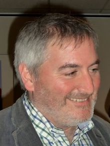 A photograph of Chris Riddell's face, smiling