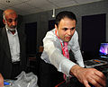 Col Abdel Latif learns how to use the new studio control room equipment (4571760068).jpg