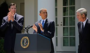 James Comey - Comey (left), alongside President Obama (center) and outgoing FBI Director Robert Mueller (right) at Comey's nomination to become FBI Director, June 21, 2013