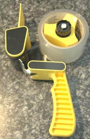 Box-sealing tape - Common packing tape gun.