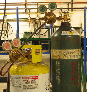 MAPP gas - A set of MAPP and oxygen cylinders used for oxy-fuel welding and cutting.