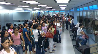 Foreign domestic helpers in Hong Kong - Foreign domestic workers queuing at counters at the Immigration Department in Wan Chai in late August 2008