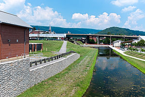 Cumberland, Maryland - Terminus of the Chesapeake and Ohio Canal in Cumberland. Highway bridge is Interstate 68. Canal place museum is the brick building behind bridge.
