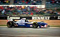 Damon Hill - Williams FW17 accelerates out of Copse at the 1995 Britsh GP, Silverstone (49716762446).jpg