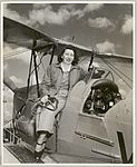 Dawn O'Mara sitting on the edge of the front cockpit of a de Havilland DH82 Tiger Moth biplane, ca. 1953 (16103893487).jpg