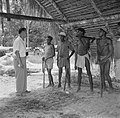 De heer Tjin A Djie met arbeiders van de houtfabriek met bijlen, Bestanddeelnr 252-2524.jpg