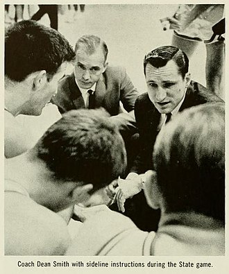 Dean Smith - Dean Smith (right) during the 1964 UNC v. North Carolina State game.