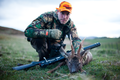 Deer stalker with roe deer buck Perthshire 01.png