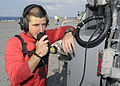 Defense.gov News Photo 100828-N-3154P-058 - U.S. Navy Petty Officer Chase Hickman checks a phone on the flight deck of the amphibious assault ship USS Kearsarge LHD 3 in the Atlantic Ocean.jpg