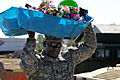 Defense.gov News Photo 110429-A-9999S-907 - U.S. Army 1st Sgt. Dwight D. Brown carries supplies to help citizens of Smithville Miss. as the community copes with severe tornado damage on.jpg