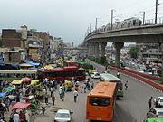 Delhi Metro and CNG Buses in Azadpur Neighborhood