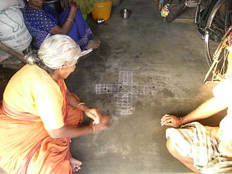 Pachisi - Pachisi being played in Tamil Nadu with Tamarind seeds and stones.