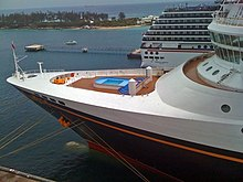 The fore section of the cruise ship seen in the other photos. There is a small pool in the middle, surrounded by white decks and walls