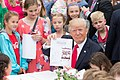 Donald Trump joins children in writing letters to soldiers during Easter egg roll (34224812752).jpg