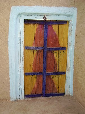 English: It is a wooden door used in rural Punjab.