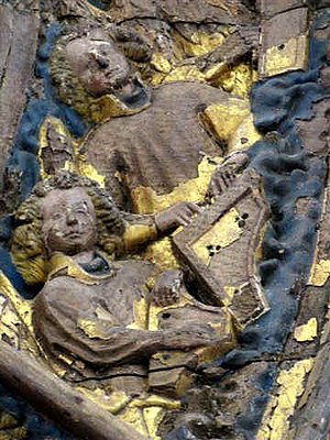 History of the harpsichord - The earliest known image of a harpsichord, from the 1425 altarpiece of the cathedral in Minden, Germany. The harpsichord is reversed in orientation in the original, not in the photograph. A second angel plays a psaltery.