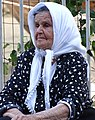Elderly Woman in Street - Tirana - Albania (42748103942).jpg