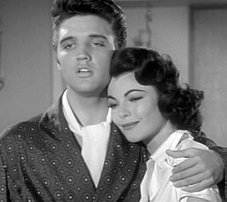 "Jailhouse Rock (film) - Presley as Vince Everett hugs Judy Tyler as Peggy Van Alden as he sings ""Young and Beautiful""."