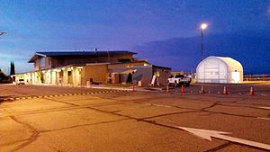 Redding Municipal Airport - Terminal expansion in progress in June, 2013. The temporary baggage claim can be seen at right.