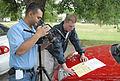 FEMA - 30780 - FEMA Community Relations worker helps a cameraman with a shot.jpg