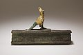 Falcon in double crown surmounting a shrine shaped box for an animal mummy MET 41.160.107 EGDP016655.jpg