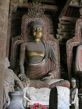 Fengguo Temple - A statue of Vipashyin in the main hall