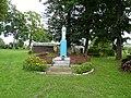 Figurka na placu przed dawnym dworkiem w Grylewie - panoramio.jpg
