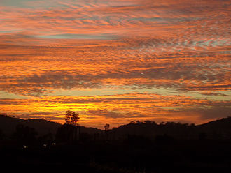 Atmospheric optics - A colorful sky is often due to indirect sunlight being scattered off oxygen molecules and particulates, like smog soot and cloud droplets, as shown in this photo of a sunset during the October 2007 California wildfires.