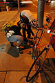 Fixie couple fixing tire (288908971).jpg