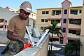 Flickr - Official U.S. Navy Imagery - A Seabee repairs a wall..jpg