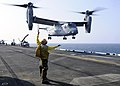 Flickr - Official U.S. Navy Imagery - USS Kearsarge Sailor directs USMC aircraft launch..jpg