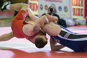 Two men in the U.S. military, one from the Navy and one from the Marine Corps, compete in freestyle wrestling.