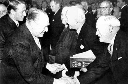 Peace Nobel Prize ceremony in 1963; From left to right: Crown Prince Harald of Norway, King Olav of Norway, ICRC president Leopold Boissier, League Chairman John A. MacAulay. Friedensnobelpreis-1963.jpg