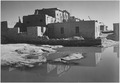 "Full side view of adobe house with water in foreground, nearly identical to item NWDNS-79-AA-A01, ""Acoma Pueblo (Nationa - NARA - 519832.TIF"