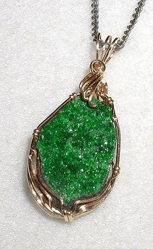 Uvarovite - Pendant in uvarovite, a rare bright-green garnet. The long dimension is 2 cm (0.8 inch)