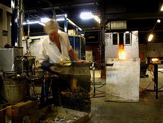 Studio glass - A vase being created at the Reijmyre glassworks, Sweden