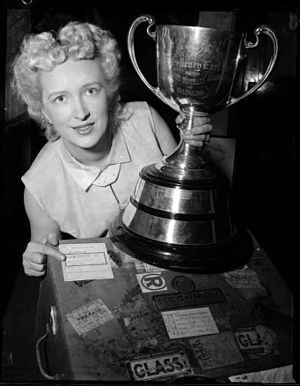 Grey Cup - Woman poses with Grey Cup in 1955.