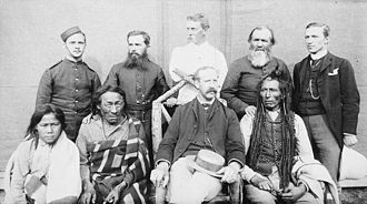 Aylesworth Bowen Perry - Group of nine taken in the square of the North-West Mounted Police Barracks, 1889 at Regina (Saskatchewan) Poundmaker, Big Bear, Big Bear's son, Father Andre, Father Conchin, Chief Stewart, Capt. Deane, Mr. Robertson, and the court interpreter