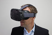 HTC executive director of marketing Jeff Gattis wearing a Vive headset.