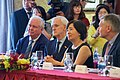 Harvard's Vietnam Program Director Valley and Former U.S. Senator Kerrey Listen as Secretary Kerry Addresses Attendees at a Ceremony to Mark the Licensing of the U.S.-Supported University in Ho Chi Minh City (27178241152).jpg