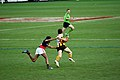 Hawthorn player evades tackle.jpg