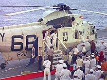 The Apollo 8 crew shown disembarking Helicopter 66 aboard USS Yorktown following their return to Earth