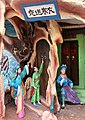 Hong Fu Nu delivers a winter coat to Li Jing on a cold night, Haw Par Villa (14791543894).jpg