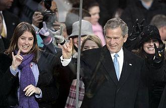 Hook 'em Horns - George W. Bush displays the Hook 'em Horns.