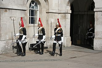 Guard mounting - Members of the Blues and Royals leave with a relieved guardsman at the end of a guard mounting ceremony in London, United Kingdom.