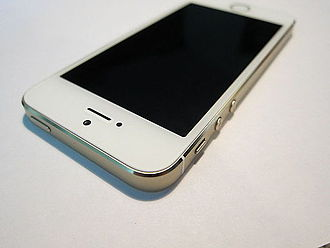 IPhone - The top and side of an iPhone 5S, externally identical to the iPhone 5. From left to right, sides: wake/sleep button, silence switch, volume up, and volume down.