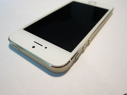 The top and side of an iPhone 5S, externally identical to the iPhone 5. From left to right, sides: wake/sleep button, silence switch, volume controls. - iPhone