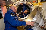 ISS-57 Alexander Gerst welcomes the new crew in the Poisk module.jpg